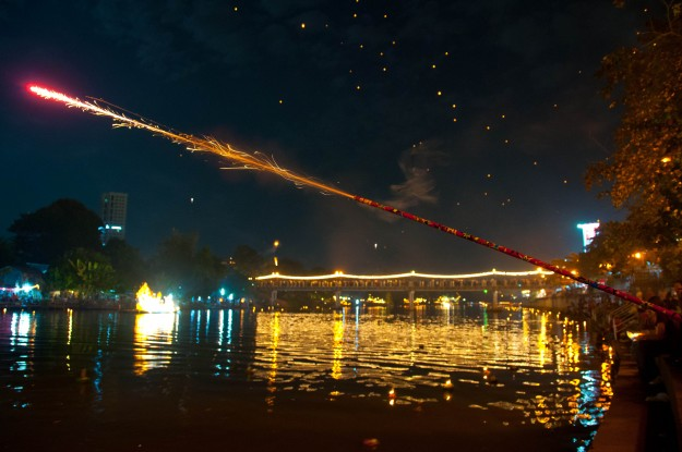 Handheld fireworks are also part of the festivities during Loi Krathong.